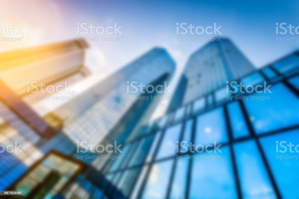 Abstract background blur bokeh image of modern skyscrapers in new...