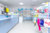 istock abstract background blur shelf with medicines and other goods in pharmacy store 973900608
