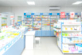 istock abstract background blur shelf with medicines and other goods in pharmacy store 973900610