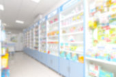 istock abstract background blur shelf with medicines and other goods in pharmacy store 973900614