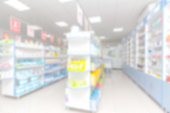 istock abstract background blur shelf with medicines and other goods in pharmacy store 973900632