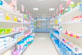 istock abstract background blur shelf with medicines and other goods in pharmacy store 978360190