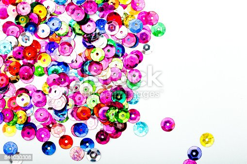 istock Abstract Background - close up of multi colored sequins on white background 841030308