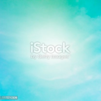 876037346 istock photo Abstract background, design template with a place for text. Teal blue sky with puffy clouds 1172212326