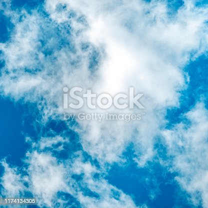 876037346 istock photo Abstract background, design template with copy space. Saturated blue sky with soft white clouds, square photo 1174134305