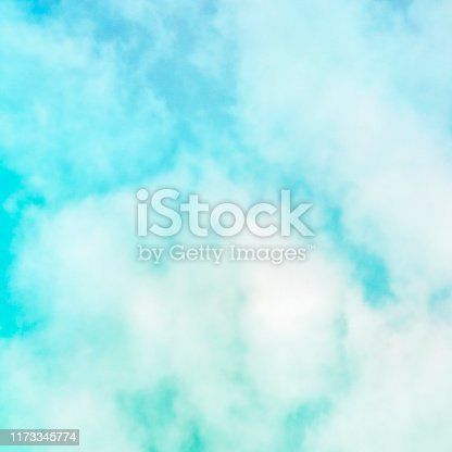 876037346 istock photo Abstract background, design template with copy space. Teal blue sky with soft clouds 1173345774