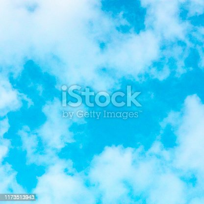 876037346 istock photo Abstract background, design template with copy space. Vibrant teal blue sky with soft white clouds 1173513943