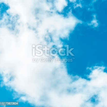876037346 istock photo Abstract background, design template with copyspace. Vibrant blue sky with soft white clouds 1173820834