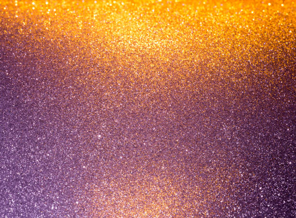 abstract background filled with shiny gold and purple glitter - scintillante foto e immagini stock