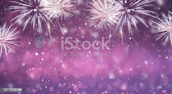 969086552istockphoto Abstract background fireworks holiday. 1077526286