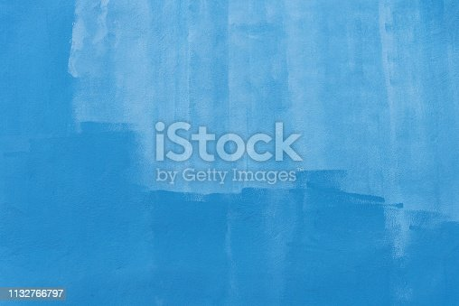 Abstract background from blue brush stroke painted on concrete wall. Vintage and retro art backdrop.