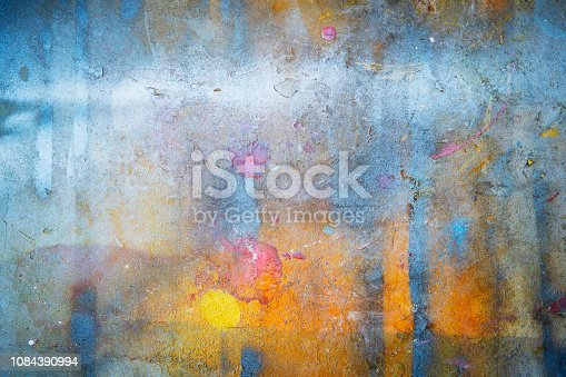 istock Abstract background from colorful painted on wall with grunge and scratched. Art retro and vintage backdrop. 1084390994