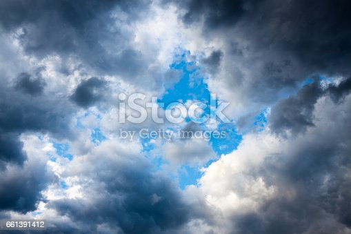 858837068istockphoto abstract background from fluffy dark storm clouds in the sky 661391412