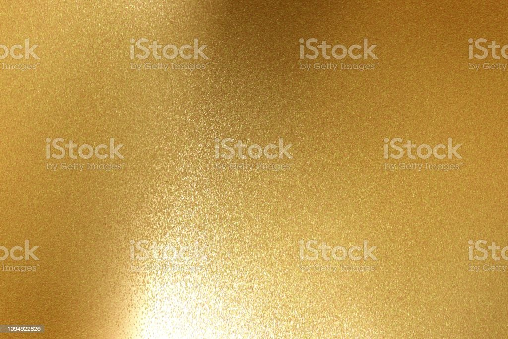 Abstract background, light shining on rough gold metal floor texture
