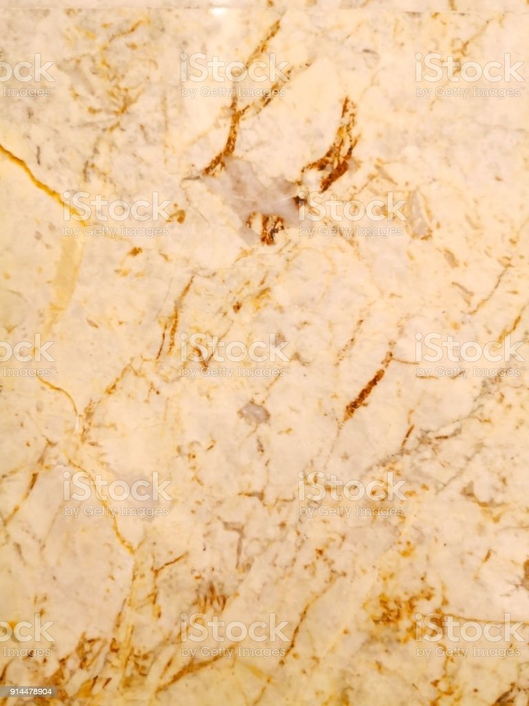 Abstract background made with marble. Closeup view of golden marble. Marble texture and background for wall design. Texture of non-foliated metamorphic rock and copy space. stock photo