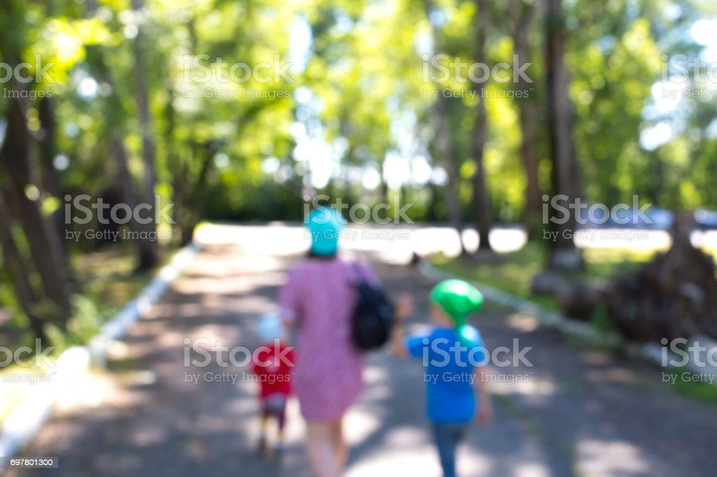 Abstract background mothers with children in the park stock photo