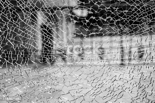 882262948 istock photo Abstract background of cobweb cracks The texture of the broken cracks. Close-up of a cracked glass. Dirty scratched broken glass of a office door 1183621462