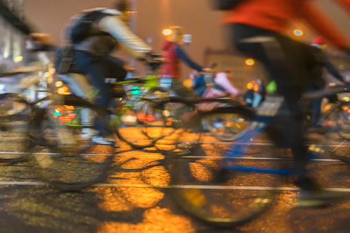 929609038 istock photo Abstract background of colored group of bicyclists on city street. Parade of bicyclists, blur effect, unrecognizable faces. Sport, fitness, healthy lifestyle concept 948188724