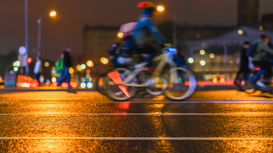 929609038 istock photo Abstract background of colored group of bicyclists on city street. Parade of bicyclists, blur effect, unrecognizable faces. Sport, fitness and healthy lifestyle concept, For backdrop 948683550