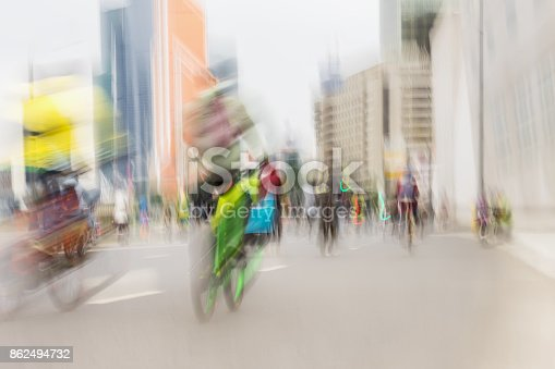 istock Abstract background of colored group of Mass bicycle ride in city, marathon, blur effect, unrecognizable faces. Sport, fitness and healthy lifestyle concept 862494732