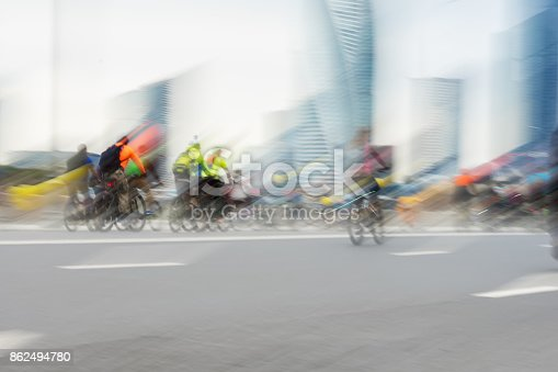 863454090 istock photo Abstract background of colored group of Mass bicycle ride in city, marathon, blur effect, unrecognizable faces. Sport, fitness and healthy lifestyle concept 862494780