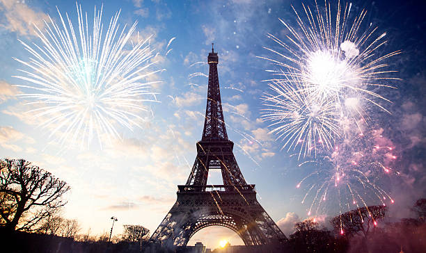 abstract background of eiffel tower with fireworks - eiffel tower stock photos and pictures