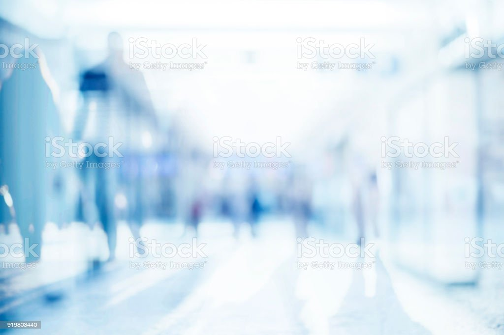 Abstract background of empty space with silhouettes of people passing by stock photo