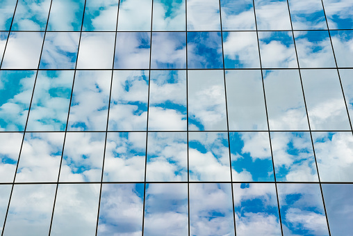Abstract Background Of Glass Office Building Reflecting A Cloudy Sky Stock Photo - Download Image Now