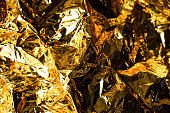 istock Abstract background of golden color from paper. 1127339742