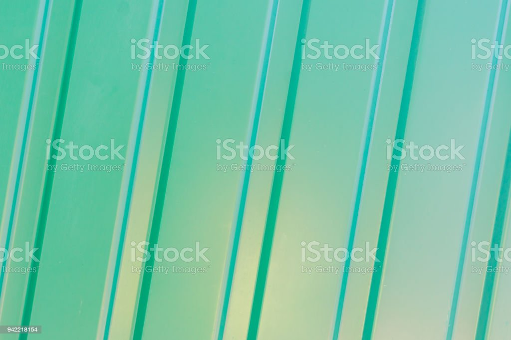 abstract background of green matal fence stock photo