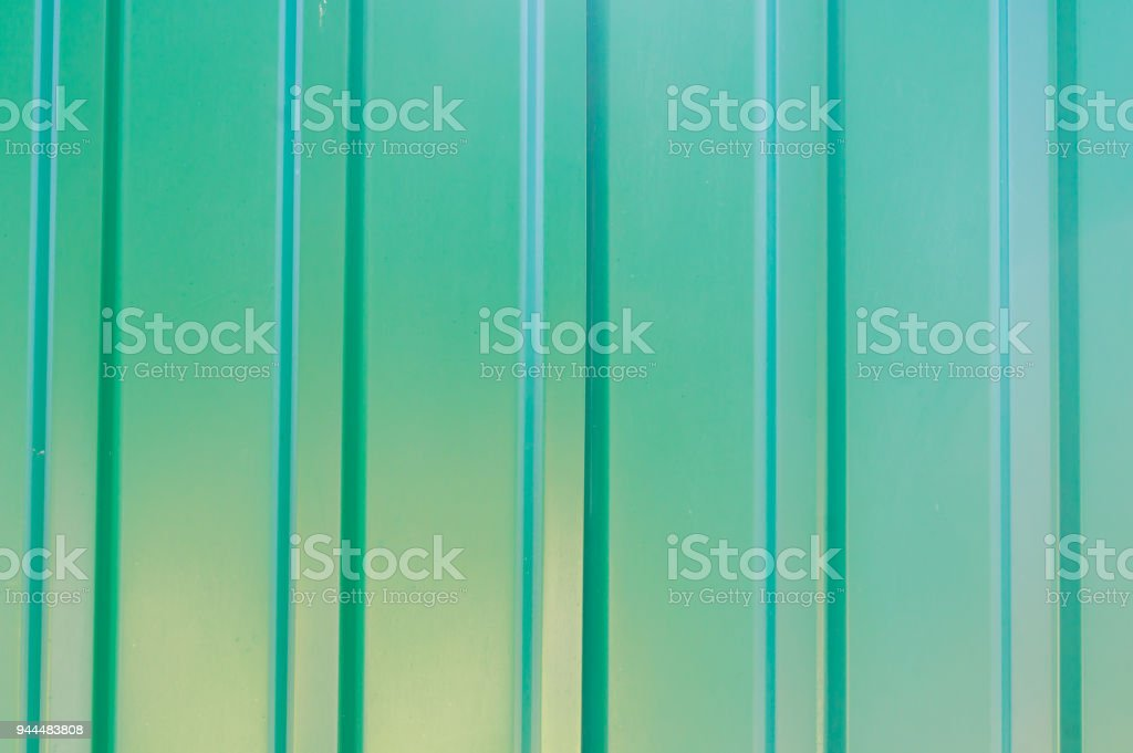 abstract background of green metal fence stock photo
