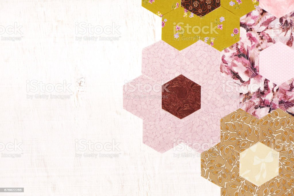 Abstract background of hexagonal pieces of fabric Grandmother's Flower Garden quilt stock photo