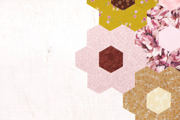 abstract background of hexagonal pieces of fabric grandmother's flower garden quilt - quilt stock photos and pictures
