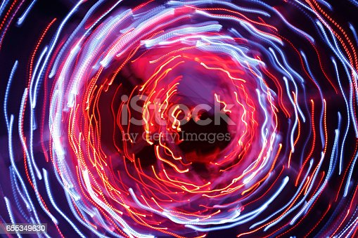 991205326 istock photo Abstract background of light trails 655349630