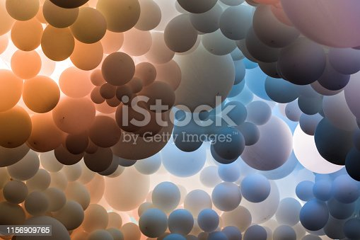 istock Abstract background of many blue and purple balloons floating in a row 1156909765