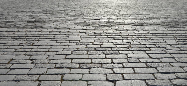 abstract background of old cobblestone pavement - 자갈 바위 뉴스 사진 이미지