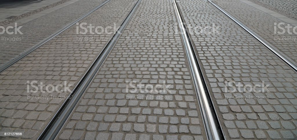Abstract background of old cobblestone pavement stock photo