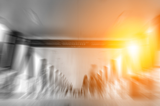 Abstract background of people walk on footbridge at rush hour in B&W color with sunlight