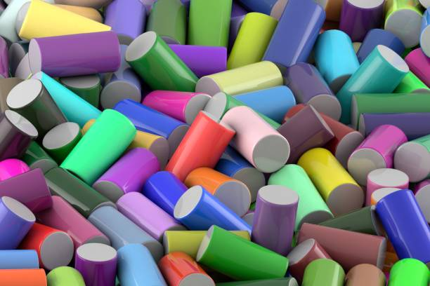 Abstract background of randomly arranged colored glossy cylinder stock photo