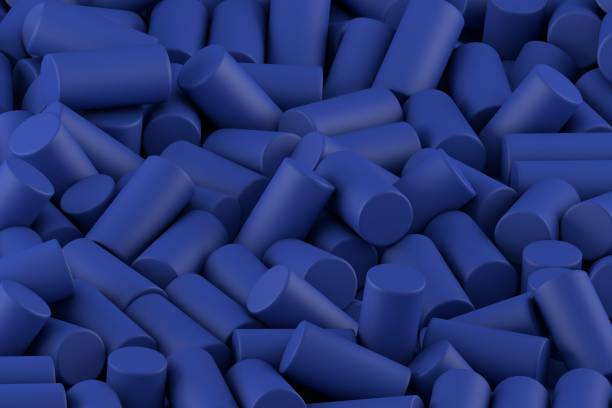 Abstract background of randomly arranged matte cylinders of blue stock photo