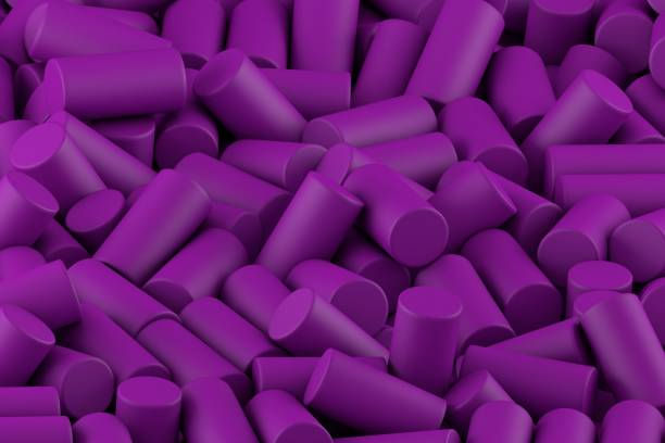 Abstract background of randomly arranged matte cylinders of purp stock photo