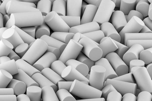 Abstract background of randomly arranged matte cylinders of white. 3d rendering stock photo