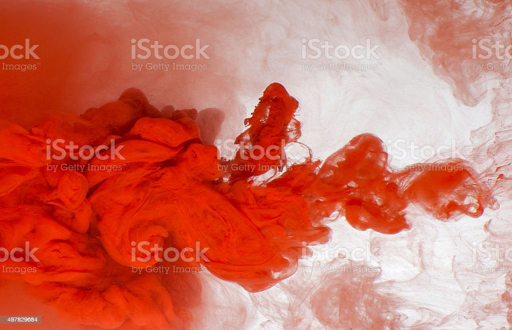 Abstract background of red acrylic paint in water. stock photo
