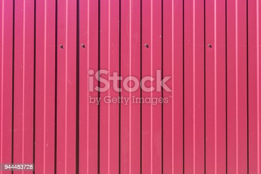istock abstract background of red metal fence 944483728