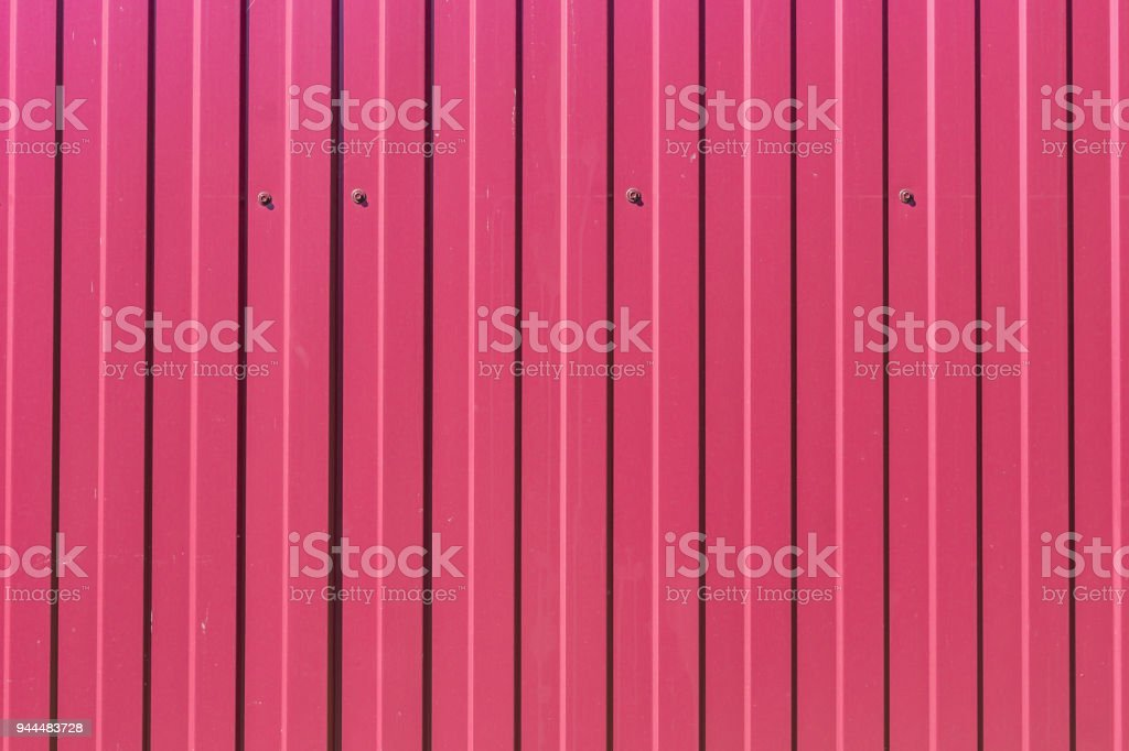 abstract background of red metal fence stock photo