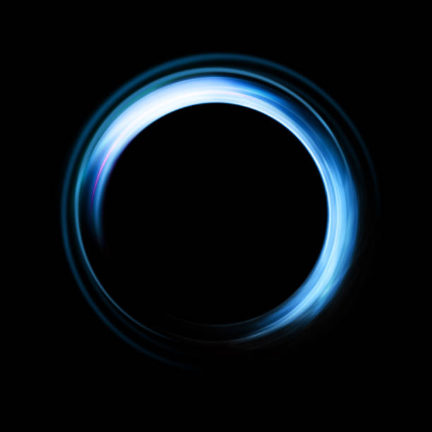 Abstract Background of ring light with luminous swirling on black stock photo