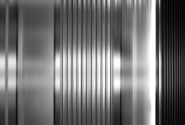 Abstract background of vertical stainless steel panels stock photo