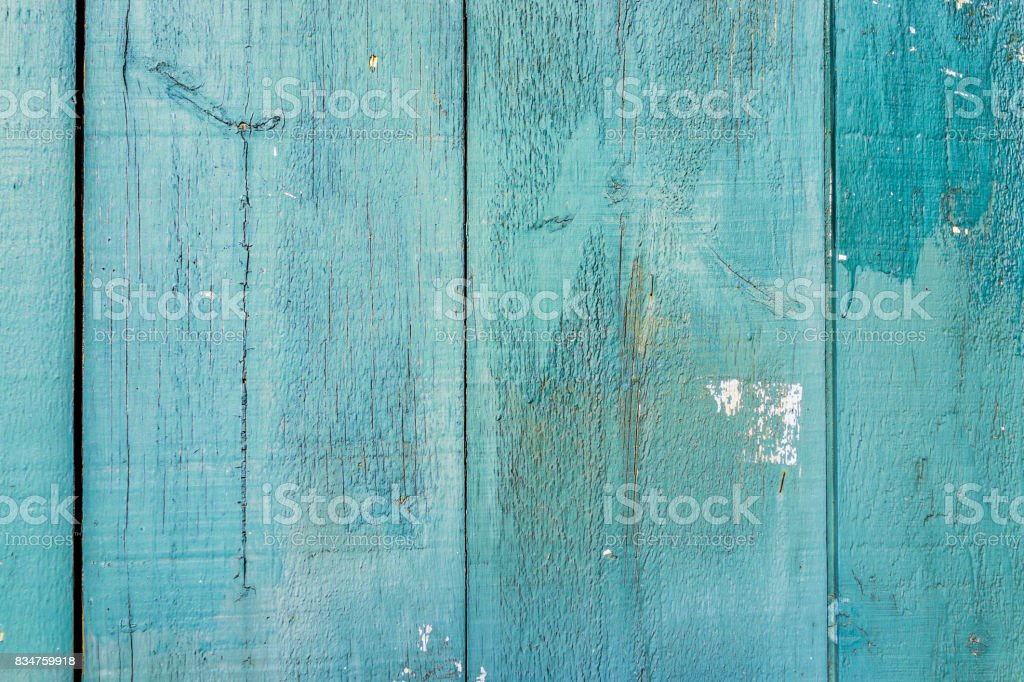 Abstract background pattern of old, vintage painted aqua green wooden panels of house stock photo