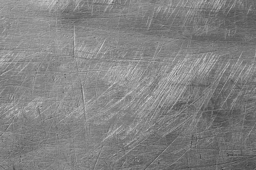 Macro shot of scretched metal background, creating an abstract grungy background
