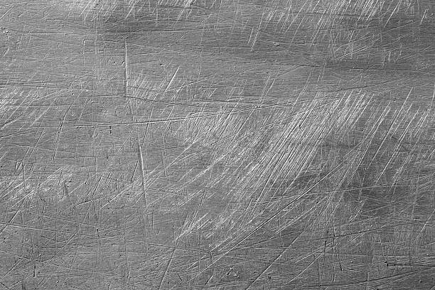 Abstract background Macro shot of scretched metal background, creating an abstract grungy background metal stock pictures, royalty-free photos & images